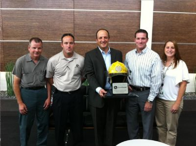 During a visit to the city of Moore in late July, the city representatives and Steve Shawn presented a plaque to Domenic Ruccolo; Mike Mack, president, Worldwide Construction & Forestry Division; and others from the C&F Division for John Deere's assistance during the aftermath of the May 20 tornado.