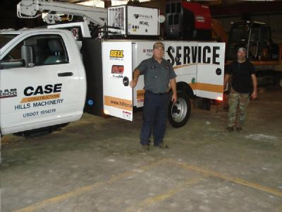 Service technicians Kip Butterfield (L) and Donnie Creech each have many years of experience working on different types of construction equipment.
